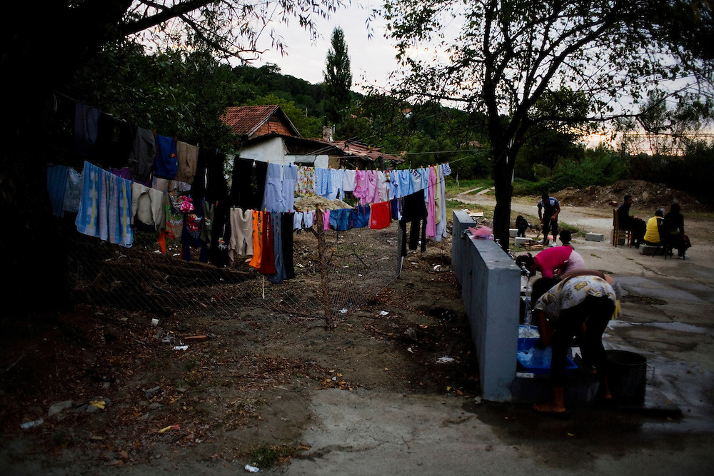 Laundry at a new washing center, Rakovica resettlement camp for Roma displaced from Gazela.
