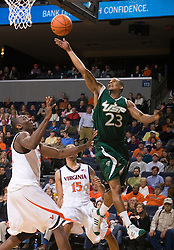South Florida guard Jesus Verdejo (23) floats a jump shot over Virginia center Tunji Soroye (21).  The Virginia Cavaliers defeated the South Florida Bulls 77-75 at the University of Virginia's John Paul Jones Arena in Charlottesville, VA on November 19, 2008.