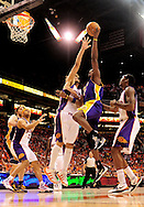 May 23, 2010; Phoenix, AZ, USA; Los Angeles Lakers forward Lamar Odom (7) puts up a shot against Phoenix Suns center Robin Lopez (15) during the fourth quarter in game three of the western conference finals in the 2010 NBA Playoffs at US Airways Center.  The Suns defeated the Lakers 118-109.   Mandatory Credit: Jennifer Stewart-US PRESSWIRE