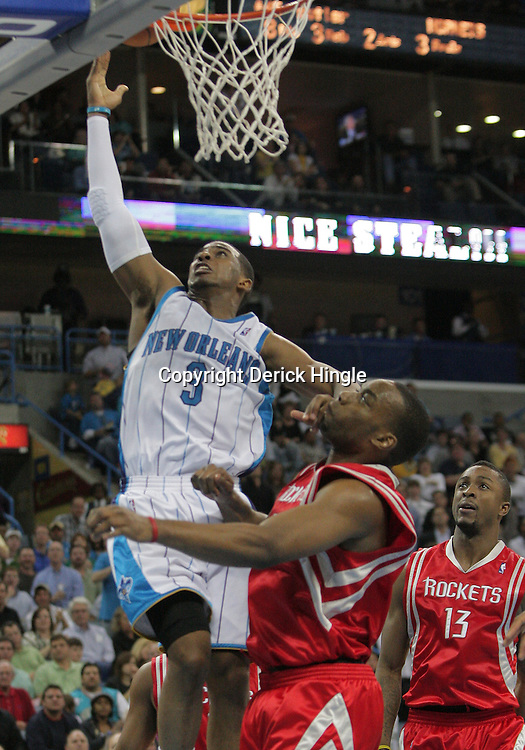 16 March 2009: New Orleans Hornets guard Chris Paul (3) shoots over Houston Rockets center Dikembe Mutombo (55) during a 95-84 loss by the New Orleans Hornets to the Houston Rockets at the New Orleans Arena in New Orleans, Louisiana.
