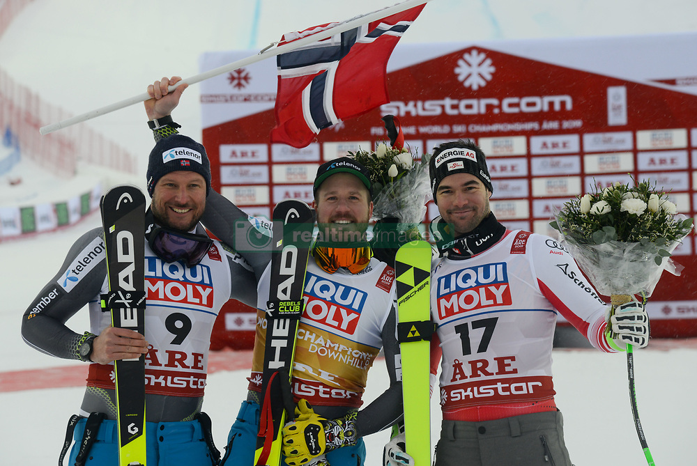 February 9, 2019 - Are, Sweden - AKSEL LUND SVINDAL of Norway (left , 2nd place ) , KJETIL JANSRUD of Norway (center, winner ) and VINCENT KRIECHMAYR of Austria (right, 3rd place ) after the Men's Downhill ski race at the FIS Alpine World Ski Championships in Are Sweden. (Credit Image: © Christopher Levy/ZUMA Wire)