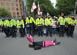 """© Licensed to London News Pictures.  10/09/2017; Bristol, UK. A woman is removed from the road by police, part of a Counter demonstrators' protest against a group called British and Immigrants United Against Terrorism who joined forces with another group called Gays Against Sharia to stage a demonstration in Bristol city centre numbering about 50 people. The counter-protest was called 'Stand Up To Racism and Bigotry'. A statement issued to oppose the march says that the demonstrators """"claim falsely that they are representing the views of the LGBT+ community in Bristol,"""" adding: """"In fact, none of the organisers are LGBT+ and all the proposed speakers come from outside Bristol."""" A heavy police presence Police with riot vans dogs and horses were in attendance. Police banned face coverings, masks, banners and flags 'that might incite hatred' ahead of today's protests. Picture credit : Simon Chapman/LNP"""