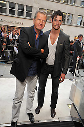 Left to right, MARIO TESTINO and DAVID GANDY at a reception hosted by Vogue and Burberry to celebrate the launch of Fashions Night Out - held at Burberry, 21-23 Bond Street, London on 10th September 2009.