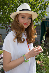 © Licensed to London News Pictures. 19/05/2014. London, England. Pictured: Model Lily Cole at the House of Fraser garden.  Press Day at the RHS Chelsea Flower Show. On Tuesday, 20 May 2014 the flower show will open its doors to the public.  Photo credit: Bettina Strenske/LNP