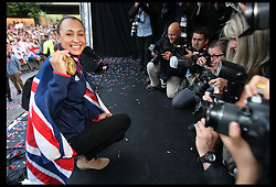 London 2012 Olympic Heptathlon Gold medalist Jessica Ennis with the Union Jack and Yorkshire flag as she welcomed back by thousands of fans at her home town of Sheffield, Friday, 17th August 2012. Photo by: Stephen Lock / i-Images<br />