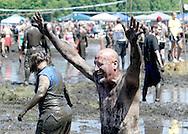 A smile through the mud during MuddyGras, the 20th annual mud volleyball for Epilepsy at Wegerzyn Gardens MetroPark in Dayton, Saturday, July 10, 2010.