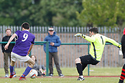 City of Liverpool's (purple) Jamie McDonald goes round   Litherland's keeper David Potter to score his second goal of the day during the North West Counties League Play Off Final match between Litherland REMYCA and City of Liverpool FC at Litherland Sports Park, Litherland, United Kingdom on 13 May 2017. Photo by Craig Galloway.