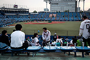 Supporters of The Tokyo swallows look for their seats at the Jingu Baseball Stadium in Tokyo before a game Tokyo Swallows VS Hiroshima Carp, Japan. 21/04/2017-Tokyo, JAPAN