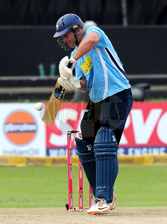 Michael Bates hitting the ball during match 8 of the Karbonn Smart CLT20 South Africa between The Titans and The Auckland Aces held at Kingsmead Park in Durban, South Africa on the 17th October 2012..Photo by Gerhard Duraan/SPORTZPICS/CLT20