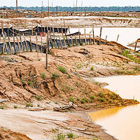 Sluices, shelters, and other infrastructure destroyed by the military are part of the aftermath of illegal and unofficial alluvial gold mining after miners were forcibly removed from the area, showing local pollution and the massive deforestation associated with the process. Following Peru's February 2019 militarized crackdown on illegal and unofficial alluvial gold mining in the La Pampa region of Madre de Dios, Wake Forest University's Puerto Maldonado-based Centro de Innovación Científica Amazonia (CINCIA), a leading research institution for the development of technological innovation for biological conservation and environmental restoration in the Peruvian Amazon, is applying years of scientific research and technical experience related to understanding mercury contamination and managing Amazonian ecosystems. What they learn will help guide urgent remediation, restoration, and reforestation efforts that can also serve as models for how we address the tropic's most dramatically devastated landscapes around the world. La Pampa, Madre de Dios, Peru.