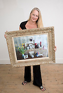 JAMES BOARDMAN / 07967642437.Christine Finn holds a photograph of her parents mantlepiece that was in  there home in Deal, Kent.  July 30, 2008.
