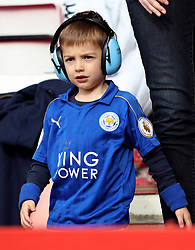 """A young Leicester City fan wearing ear protectors during the Premier League match at the Vitality Stadium, Bournemouth. PRESS ASSOCIATION Photo. Picture date: Saturday September 30, 2017. See PA story SOCCER Bournemouth. Photo credit should read: Simon Cooper/PA Wire. RESTRICTIONS: EDITORIAL USE ONLY No use with unauthorised audio, video, data, fixture lists, club/league logos or """"live"""" services. Online in-match use limited to 75 images, no video emulation. No use in betting, games or single club/league/player publications."""