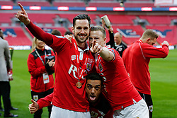 Greg Cunningham and Wade Elliott are joined by former player Scott Murray as they celebrate after Bristol City win the match 2-0 - Photo mandatory by-line: Rogan Thomson/JMP - 07966 386802 - 22/03/2015 - SPORT - FOOTBALL - London, England - Wembley Stadium - Bristol City v Walsall - Johnstone's Paint Trophy Final.