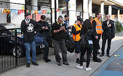 © Licensed to London News Pictures. 04/10/2015. London, UK. A small group of people gather opposite the Jack the Ripper Museum after a planned protest was cancelled as organisers feared a large amount of arrests. Photo credit: Peter Macdiarmid/LNP