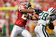 New York Jets running back Curtis Martin stiff arms Kansas City Chiefs safety Sammy Knight in the helmet during a 27 to 7 Chiefs win on September 11, 2005 at Arrowhead Stadium in Kansas City, Missouri.