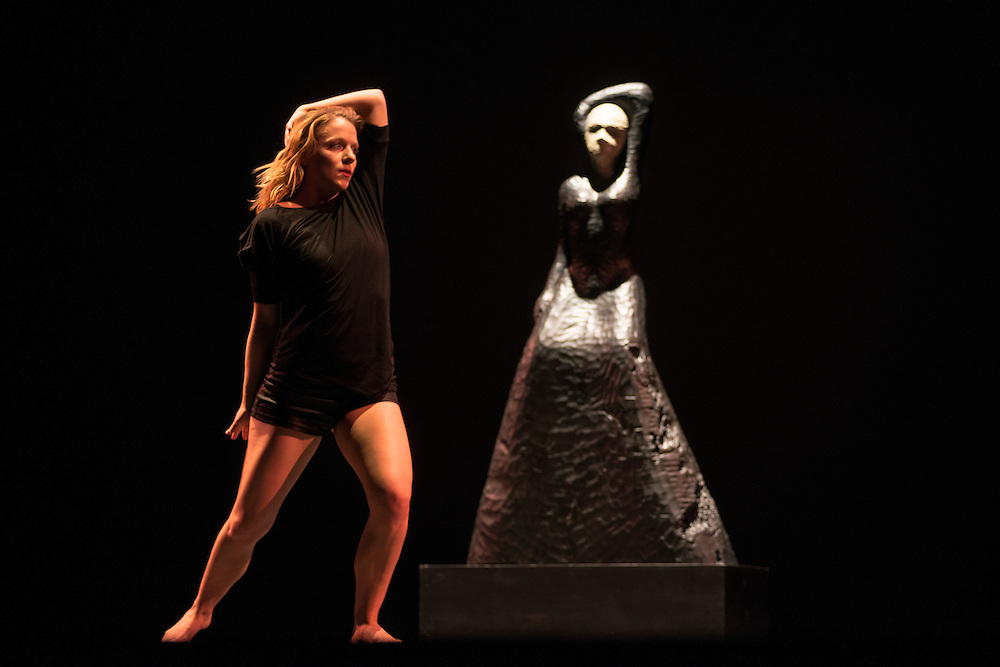 A dancer mimics the spirit of the sculpture made by special guest, David Hostetler at Ohio University's 4th Annual World Music & Dance Concert, Global Excursions, on Satruday, February 2, 2013.