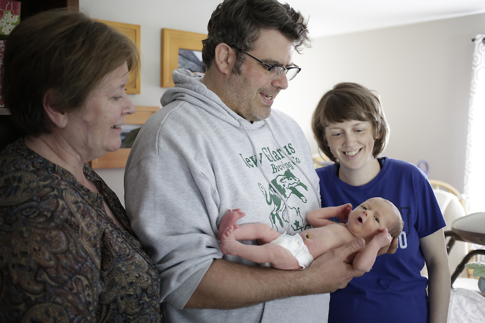 Stella, Emily, Gus and baby Jack at home in Comstock Park, Mich. on Friday, May 23, 2014. (Photo by Jason Redmond)