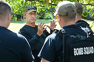 EDITORS NOTE: SHERIFF DECLINED TO IDENTIFY BOMB SQUAD MEMBERS: Montgomery County Sheriff's Office Bomb & Hazardous Device Disposal Unit's Lt. Allen Stewart gives last minute instructions to team members before they work to disarm a device during an emergency training exercise at Arcadia University's Crime Scene House in preparation for the Pope's visit to Philadelphia Wednesday August 12, 2015 in Cheltenham, Pennsylvania. (Photo by William Thomas Cain)