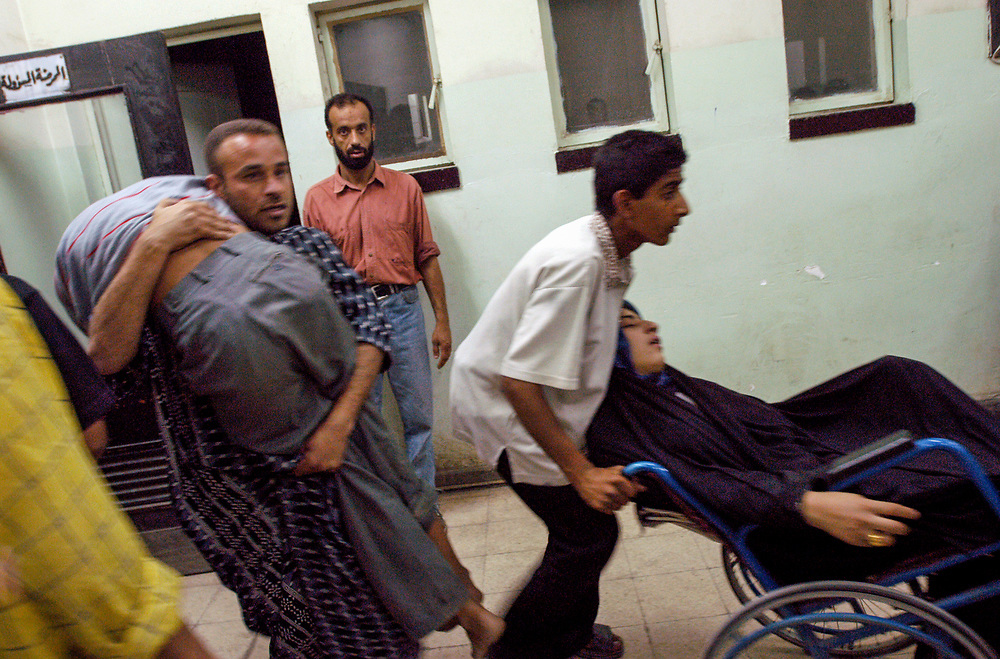 Patients arrive at the al-Kadisia Hospital emergency room in Thora City, formerly known as Saddam City, where 3 million oppressed and marginalized Shiite muslims live. The neighborhood is a hotbed for the insecurity and violence that has thrived with the absence of authority in the country.<br /> Baghdad, Iraq. 06/05/2003.