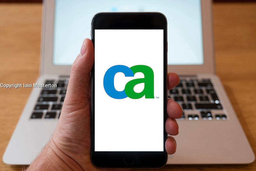 Using iPhone smartphone to display logo of CA Technologies , information technology company