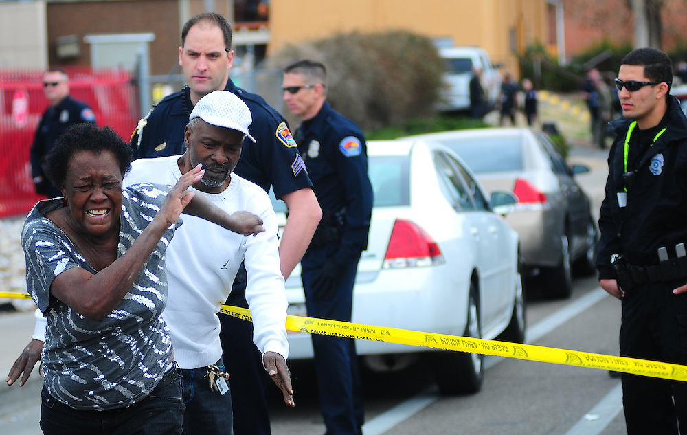 apl031913o/ASECTION/Pierre-Louis/Albuquerque Journal/031813 <br /> Family members react after finding out that the suspect in the  APD SWAT situation near Constitution and Indian School was deceased on Tuesday March 19 ,2013 . (Adolphe Pierre-Louis/Journal)