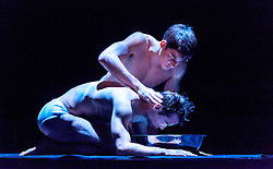 Edinburgh, Scotland, UK 18th August 2016 ::  The cast of Scottish Ballet perform Angelin Preljocaj's MC 14/22 (Ceci est mon corps) a hymn to the male body, a meeting of the spiritual and the carnal, a glorification of masculinity and a condemnation of force. Performed by 12 male dancers representing the Apostles of Jesus, this powerfully sensual work takes as its starting point the Last Supper as related in the Gospel of St Mark, chapter 14, verse 22 as Christ breaks bread and announces to his disciples: 'Take it; this is my body.'  Pictured: Christopher Harrison and Javier Andreu<br /> <br /> (c) Andrew Wilson | Edinburgh Elite media