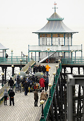 © Licensed to London News Pictures. 24/03/2014; Clevedon, UK. One Direction filming on Clevedon Pier. It is believed the band - Harry Styles, Zayn Malik, Liam Payne, Niall Horan and Louis Tomlinson - were filming for a new music video. Photo credit: Simon Chapman/LNP