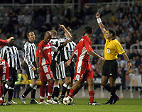 Photo. Glyn Thomas. <br /> Newcastle United v Hapoel Bnei Sakhnin. <br /> UEFA Cup, 1st round, 1st leg. 16/09/2004.<br /> Newcastle's Nicky Butt (C, arm raised) is shown the red card by referee Antonio Costa (R) after landing a punch on Abas Suan which led to a scuffle<br /> NORWAY ONLY