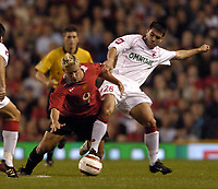 Photo. Jed Wee.<br /> Manchester United v Dinamo Bucharest, UEFA Champions League Qualifying 2nd Leg, 24/08/2004.<br /> Dinamo's Andrei Magartiescu (R) wrestles Manchester United's Alan Smith to the ground