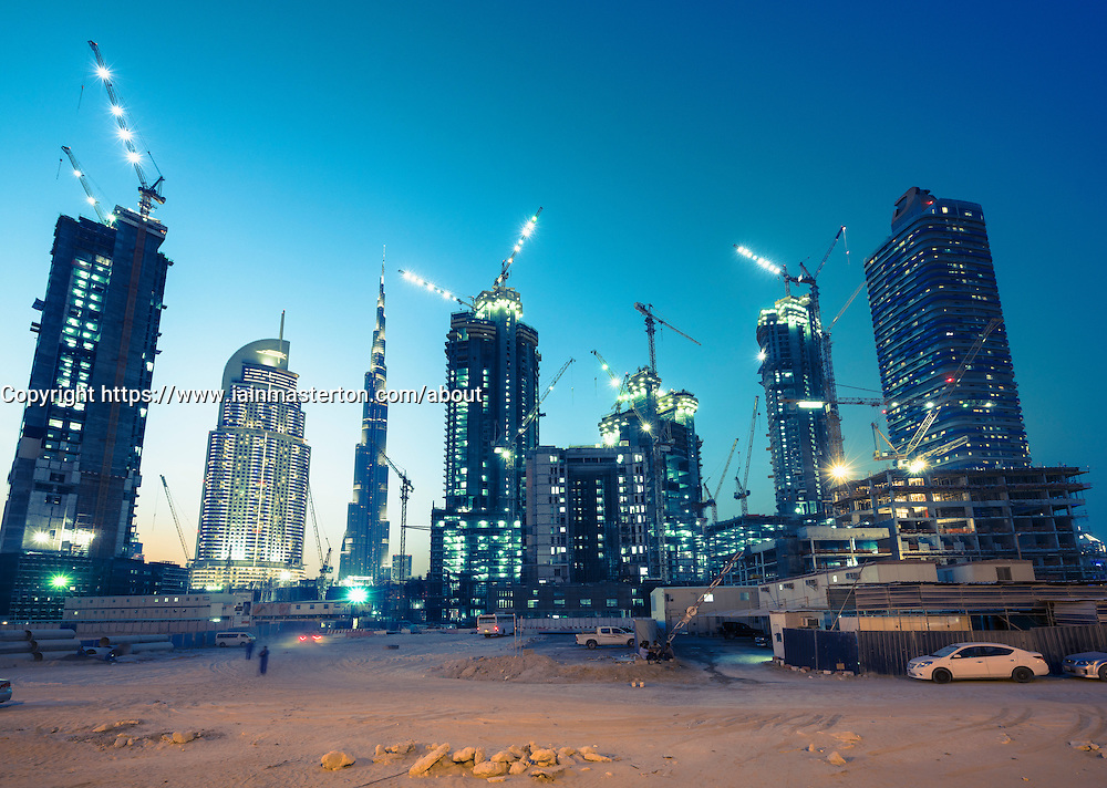 Night view of construction sites of new high-rise luxury apartment towers in Dubai United Arab Emirates