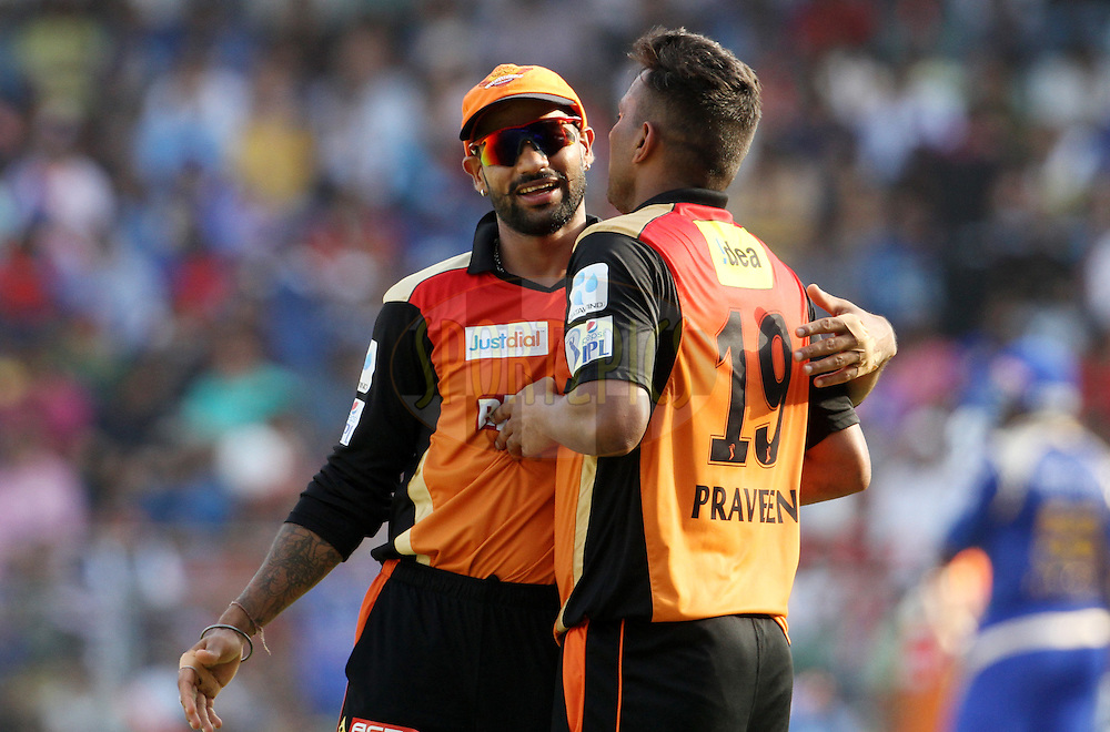 Sunrisers Hyderabad captain Shikhar Dhawan and Sunrisers Hyderabad player Praveen Kumar celebrates the wicket of Mumbai Indians player Harbhajan Singh during match 23 of the Pepsi IPL 2015 (Indian Premier League) between The Mumbai Indians and The Sunrisers Hyderabad held at the Wankhede Stadium in Mumbai India on the 25th April 2015.<br /> <br /> Photo by:  Vipin Pawar / SPORTZPICS / IPL