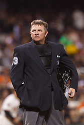 Sep 26, 2011; San Francisco, CA, USA;  MLB umpire Greg Gibson (53) stands behind home plate during the third inning between the San Francisco Giants and the Colorado Rockies at AT&T Park. San Francisco defeated Colorado 3-1.