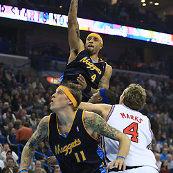 28 January 2009: Denver Nuggets forward Kenyon Martin (4) shoots over New Orleans Hornets defenders James Posey and Sean Marks (4) during a 94-81 win by the New Orleans Hornets over the Denver Nuggets at the New Orleans Arena in New Orleans, LA. The Hornets wore special throwback uniforms of the former ABA franchise the New Orleans Buccaneers for the game as they honored the Bucs franchise as a part of the NBA's Hardwood Classics series. .