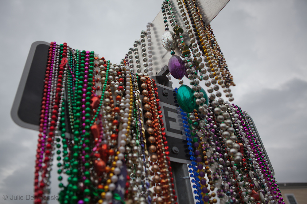 Traffic sign cover in Mardi Gras beads at a memorial to a two year old victim killed by gunshots in New Olreans, a city plagued with gun voilence.