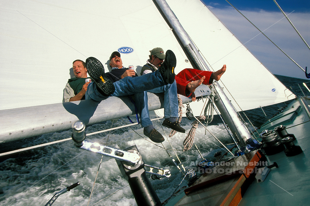 USA, Newport, RI - 12 Meter crew whoops it up on some time off sailing aboard Nefertiti in Newport Harbor.