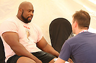 Journalist Alistair Ross (The Sun, UK) interviews Mark Felix (UK) at the World's Strongest Man competition held in Sun City, South Africa.
