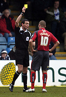 Photo: Olly Greenwood.<br />Gillingham v Swansea City. Coca Cola League 1. 25/03/2006. Swanseas Lee Trundle is booked by referee Mr A Marriner.