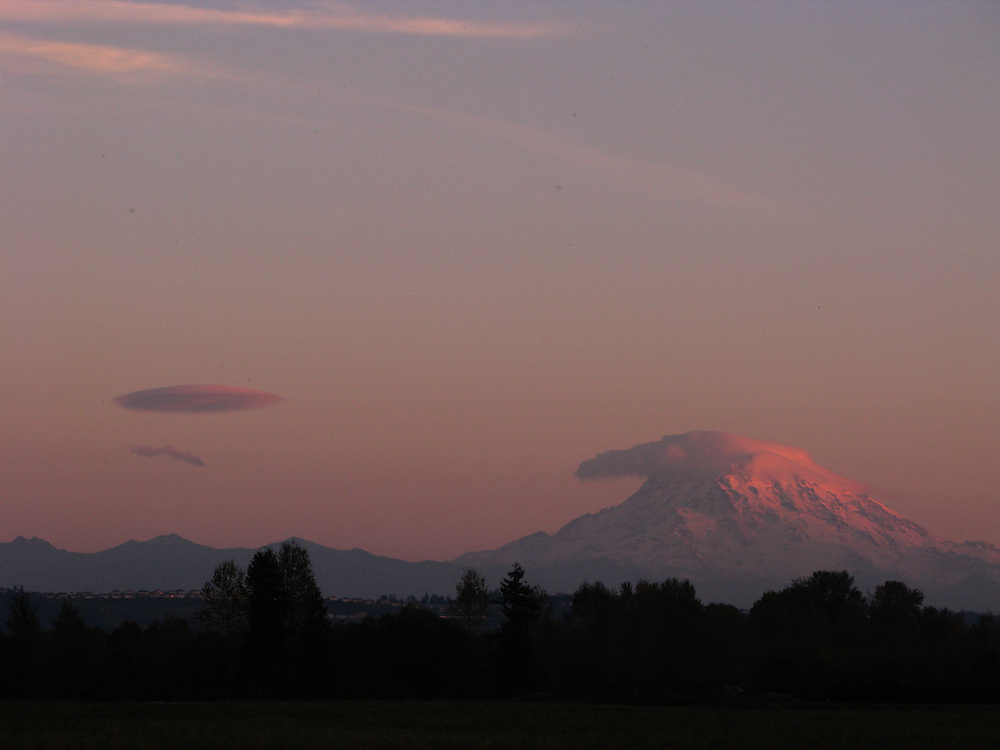 A view of Mt Rainier from Pierce County farmlands at the end of a sunny Winter's day.