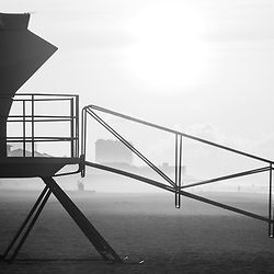 Pensacola Beach Florida lifeguard tower two sunrise black and white panorama photo on Casino Beach. Pensacola Beach is a coastal city on Santa Rosa Island in the Emerald Coast of the Southeastern United States of America. Panoramic ratio is 1:3. Copyright ⓒ 2018 Paul Velgos with All Rights Reserved.