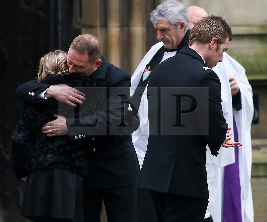 © Licensed to London News Pictures. 06/12/2016. Wakefield, UK. Two mourners attend the funeral of Andrew Broadhead and his daughter Kiera takes place at Wakefield Cathedral in West Yorkshire. Andrew Broadhead, 42, died whilst trying to save his 8-year-old daughter Kiera from a house fire. Photo credit : Ian Hinchliffe/LNP