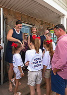 Massapequa, New York, USA. August 5, 2018. L-R, JOANNE CURRAN PERRUCCI, candidate for Court Judge 4th District; and LAURA CURRAN, Nasssau County Executive, are smiling with Perrucci's four children, at opening of fellow Democrats' campaign office, aiming for a Democratic Blue Wave in November midterm elections.