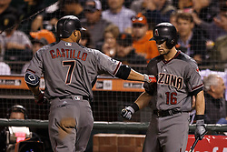 SAN FRANCISCO, CA - APRIL 18:  Welington Castillo #7 of the Arizona Diamondbacks is congratulated by Chris Owings #16 after hitting a home run against the San Francisco Giants during the fourth inning at AT&T Park on April 18, 2016 in San Francisco, California.  (Photo by Jason O. Watson/Getty Images) *** Local Caption *** Welington Castillo; Chris Owings