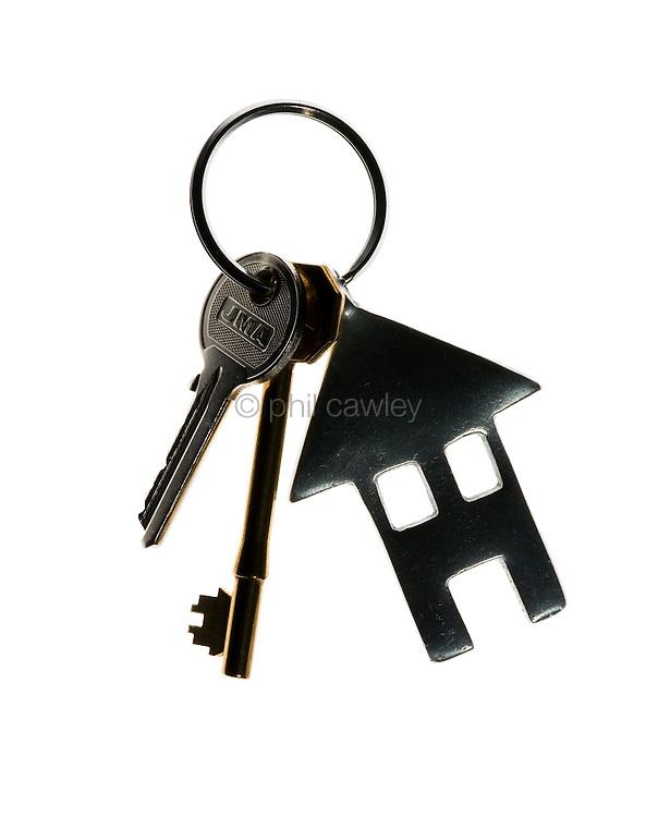 House keys with a house shaped key fob