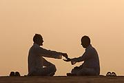 Men doing yoga in the early morning on the ridge near the Mehrangarh Fort in Jodhpur. Rajasthan, INDIA