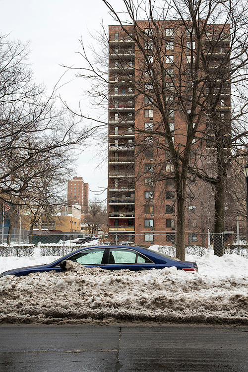 A blue car, parked on the street outside a tower block of flats in Upper West Side, New York City,  New York, United States of America, buried in snow after the snowstorm in January 2016. The snowstorm brought more than 2 feet of snow in many areas, which broke many records.  (photo by Andrew Aitchison / In pictures via Getty Images)