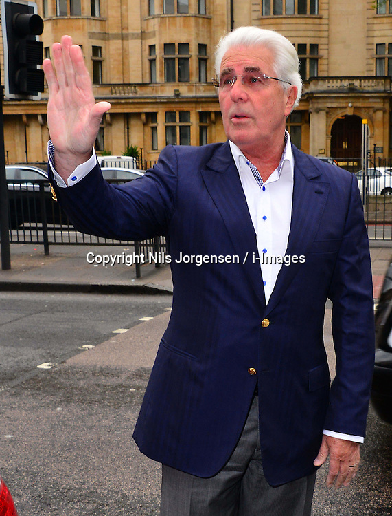PR guru Max Clifford and his Partner Jo Westwood arrives at Westminster Magistrates' Court, London, charged with 11 indecent assaults allegedly committed between 1966 and 1985, Tuesday, 28th May 2013. Picture by Nils Jorgensen / i-Images