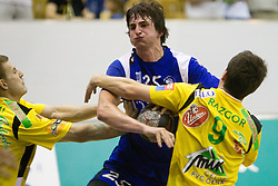 Jernej Papez of Trimo vs David Razgor of Celje during handball match between RK Celje Pivovarna Lasko and Trimo Trebnje of last Round of 1st Slovenian Handball league, on May 27, 2011 in Arena Zlatorog, Celje, Slovenia. Celje defeated Trimo 32-28 and win 3rd place in Slovenian National Championship. (Photo By Vid Ponikvar / Sportida.com)