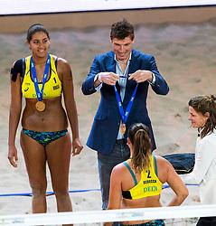 06-01-2019 NED: Dela Beach Open, Den Haag<br /> Brazil Ana Patricia Silva Ramos #1 BRA/ Rebecca Cavalcanti Barbosa Silva #2 BRA win the bronze medal / Bas van de Goor gives the gold medal Rebecca Cavalcanti Barbosa Silva