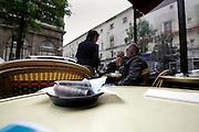 money on table Paris cafe sidewalk terrace
