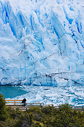 A couple admiring the size and power of the Perito Moreno Glacier in Argentina,Patagonia,Argentina,South America